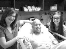 Grant Hebert sits in his hospital bed next to his mother Malissa and his sister Morgan. Hebert passed away Nov. 8 at the age of 20.