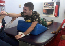 Stroke survivor Kurt Leblanc exercises during a routine physical therapy session. Kurt is a semi-finalist for the High School Rudy Awards.