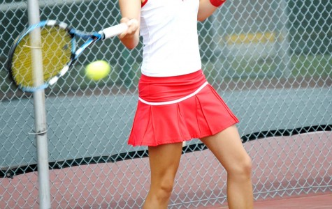 Senior Natalia Zamora volleys during last year's game against Southern.