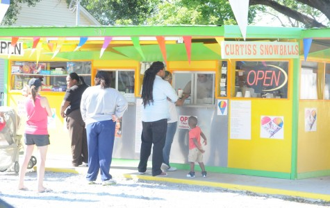 Customers wait in line at Curtis's Snowball Stand to quench their thirst.