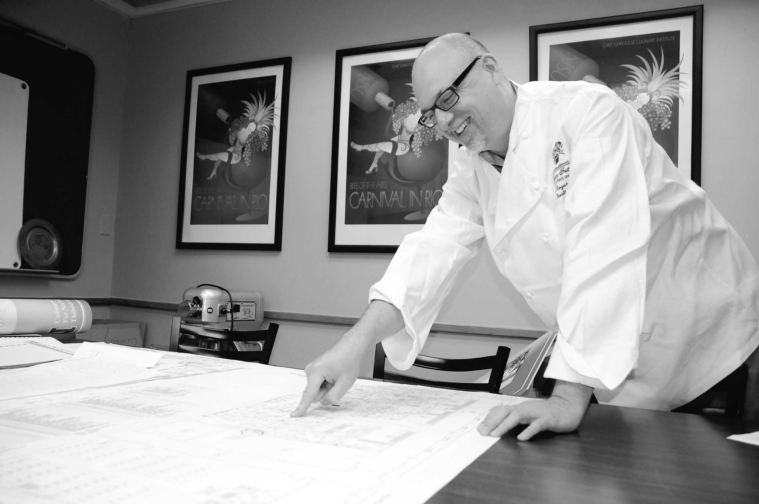 Chef John Kozar, MBOE, department head checks out the official blueprints for the new culinary building on August 17, 2012