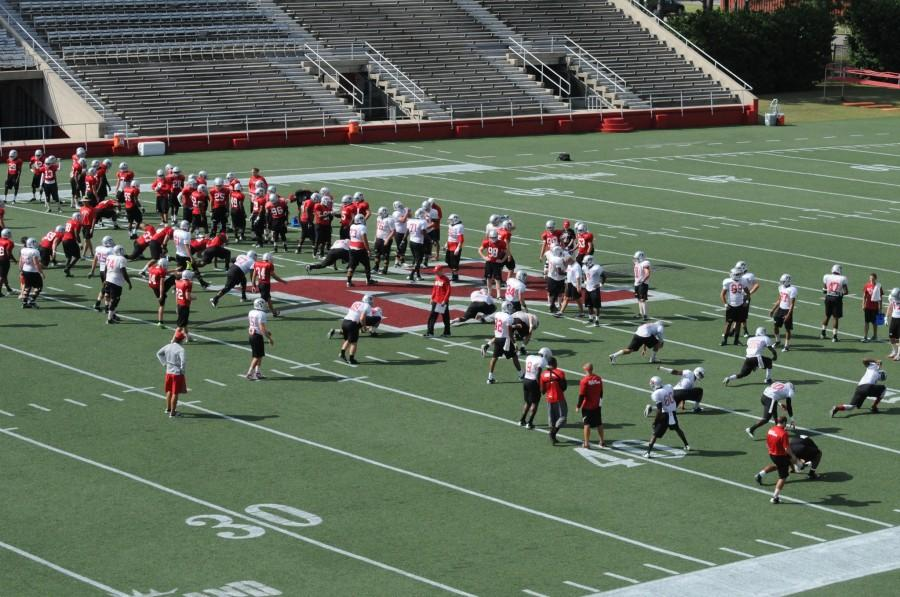 The+Nicholls+State+football+team+warms+up+before+practice+on+Thursday.
