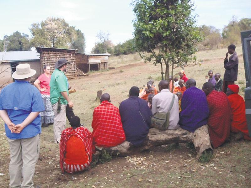 Hilton Johns speaks to villagers in Kenya during his mission trip from Sept. 13-16.