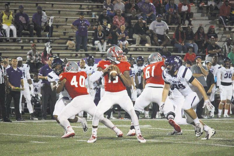 Nicholls quarterback Kalen Henderson drops back to pass during the Colonels game against Stephen F. Austin State University on Oct. 11.