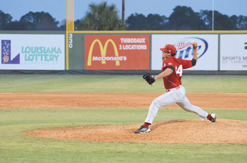 Adam Falcon, #44,  a junior from Donaldsonville, La, pitches during practice.