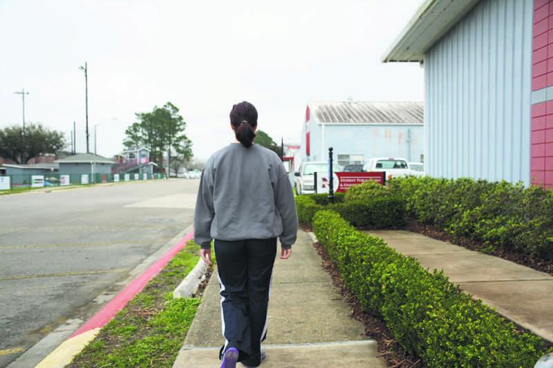 Mass communication junior Katelyn Smith wears sweatpants to walk around campus comfortably.