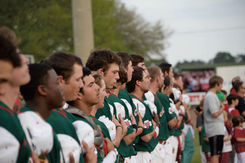 The Colonels baseball team hold their caps over their hearts for the national anthem before their game against Lamar University Cardinals on Mar. 17, 2015 at Ray E. Didier Field.