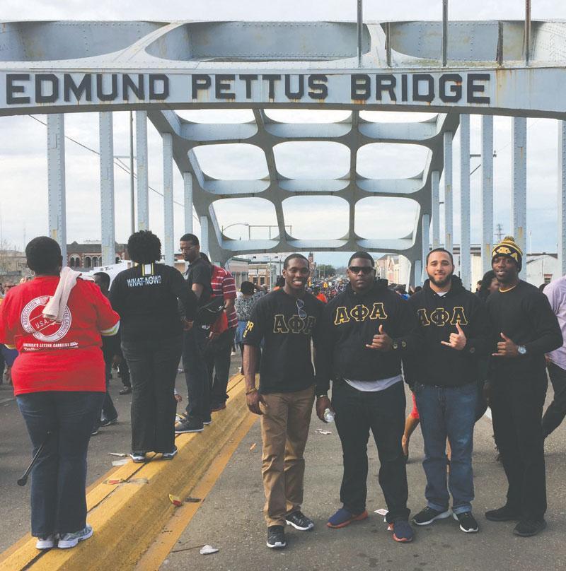 Members of the Alpha Phi Alpha fraternity: Raymond Nichols, Andrew Carter, Phazal Hines and Joshua Dewey (left to right) on the Edmund Pettus Bridge in downtown Selma.