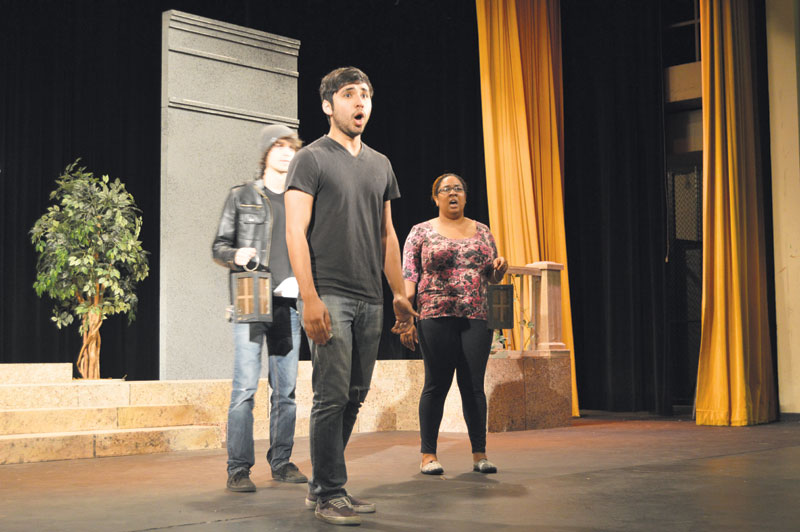 Roland Bennett, a senior voice major, and Ivanna Brooks, a senior vocal performance major, sing opera during their performance of Don Giovanni Tuesday, Apr. 21, at Mary M. Danos Theater.