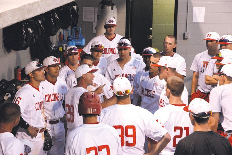 The baseball team gathers between innings and takes instruction from Assistant Coach Zach Butler during their game against Spring Hill Monday night.