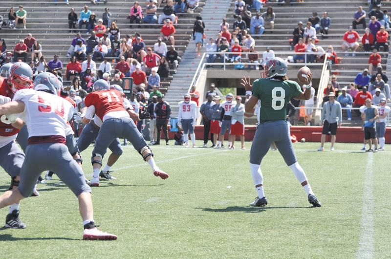 Tuskani Figaro. #8, a junior from Lafayetta, La, passes the ball to a teammate during the Colonels Spring Game Saturday.