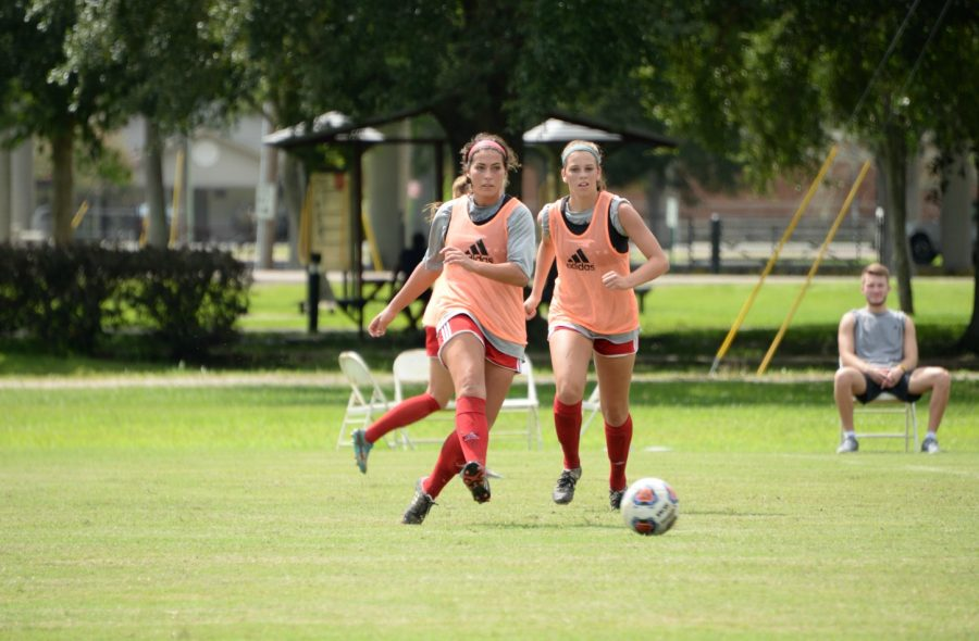 %28Left%29+%2318+Redshirt+senior+forward+Kirstie+Champagne++is+followed+by+%2325+freshman+midfielder+Hannah+Bodron+after+passing+the+ball+at+afternoon+practice+Monday%2C+August+14th.+