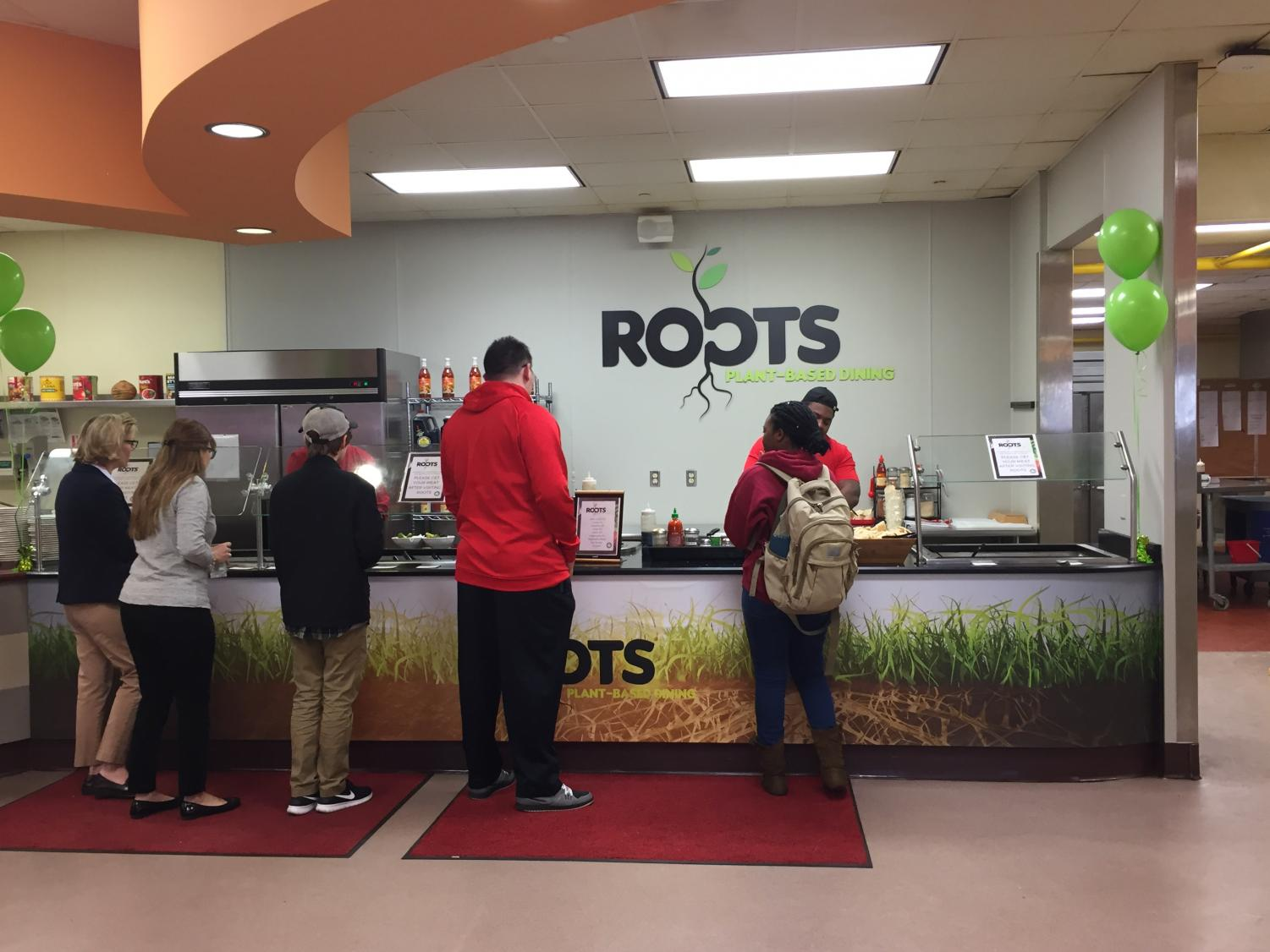 Students, faculty and staff try Roots' vegan options at its grand opening.
