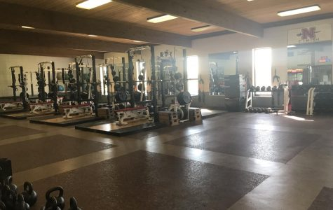 Strength coach seeks to maintain and improve consistency in weight room